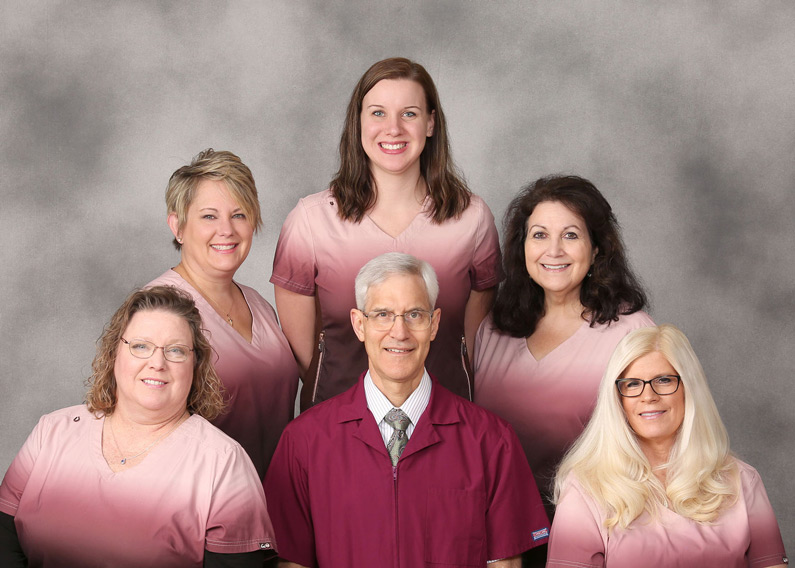 Dr Hardinger's Office Staff: Front Row, Left to Right - Tiffany, Dr, Hardinger, Carol. Back Row, Left to Right - Kara, Brittany and Helen